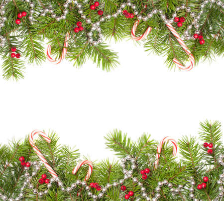 Christmas fir tree frame including baubles and candy canes with copy space