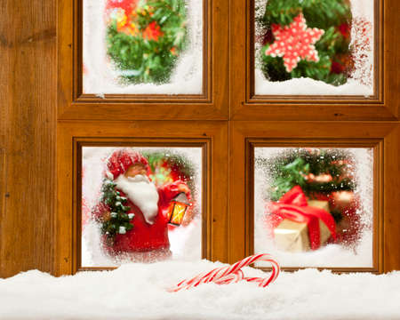 Frosty Christmas window with focus on candy canes in the snow Stock Photo - 11713590