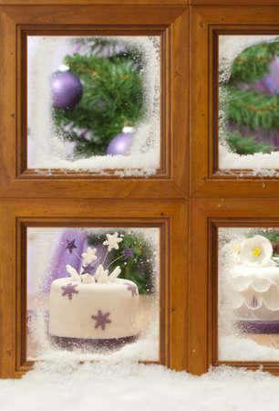 Christmas cake in a festive scene through a frosty winter window Stock Photo - 11713589