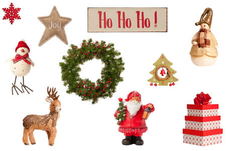 Collection of Christmas elements including gifts, festive wreath and vintage, ho ho ho sign all on a white background photo