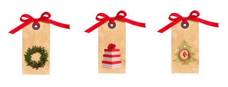Festive Christmas gift tags tied with red ribbon isolated on a white background photo