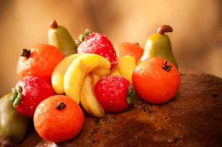 marzipan: Close up of marzipan fruits on rich fruit cake Stock Photo