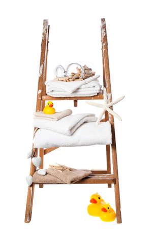 laundered: Freshly laundered towels on stepladder Stock Photo