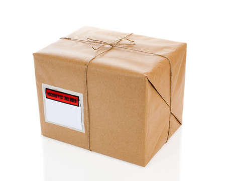 despatch: Parcel on white background with blank delivery label