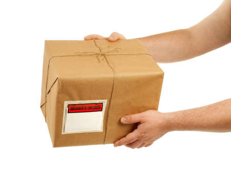 Handing over a package Stock Photo - 12463875