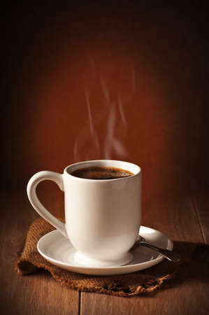 Freshly brewed coffee with steam  Stock Photo