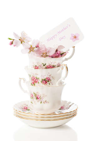 Pretty vintage cups with spring blossom for Mothers Day photo