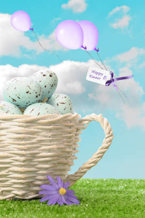 Basket of Easter eggs with Happy Easter sign and balloons floating in the sky Stock Photo - 12782140