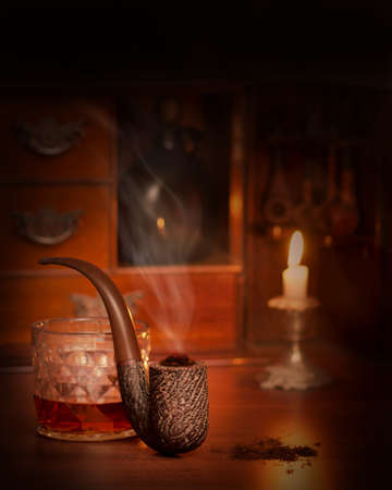 Vintage style smoking pipe with burning tobacco and smokers cabinet in background Stock Photo - 12956202