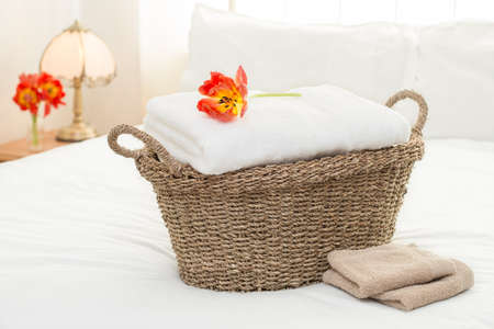 Basket of white fluffy towels in bedroom interior Stock Photo - 13447469