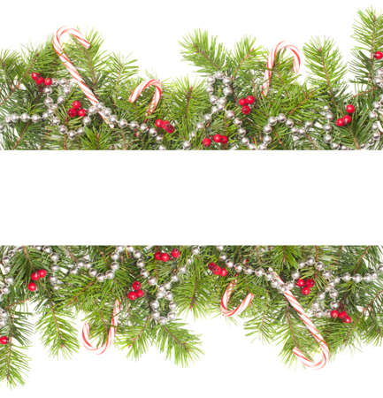 Christmas border with candy canes on a white background photo