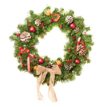 pine wreath: Christmas wreath decorated with baubles on a white background Stock Photo