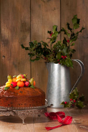 comfits: Christmas fruit cake decorated with marzipan fruits Stock Photo