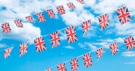 jack of diamonds: Union flag bunting in blue summer sky