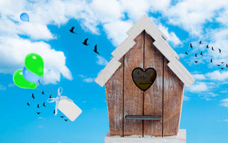 Birdhouse in the sky with floating balloons Stock Photo