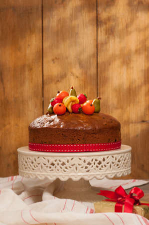 comfits: Christmas fruit cake decorated with marzipan fruits on cake stand