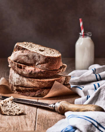 wholemeal: Slices of fresh crusty bread with knife Stock Photo