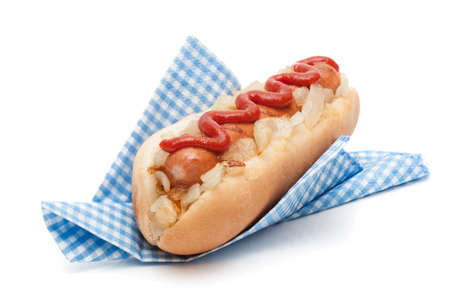 hotdog: Hot dog roll with fried onions and tomato sauce in napkin on a white background