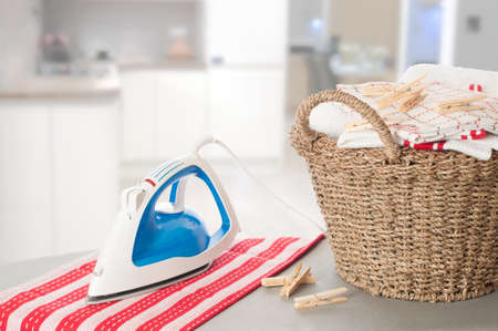 Laundry on ironing board in kitchen setting
