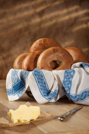 Basket of bagels with butter on rustic table Stock Photo - 14120378