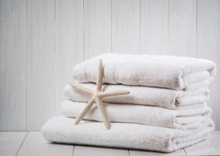 laundered: New white fluffy towels with starfish Stock Photo