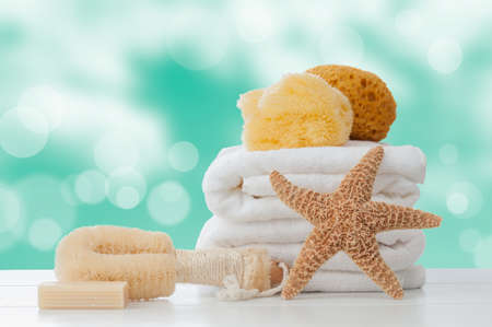 Bathroom towels with sponges and soap