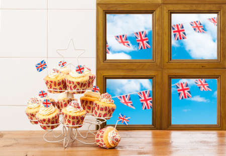 Cupcakes on stand with union flag decoration and bunting photo