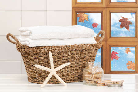 kitchen towel: Basket of washing with raindrops on window and falling autumn leaves