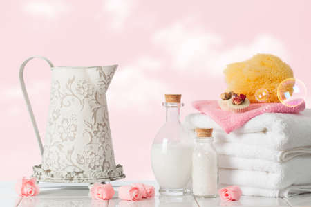 Bathroom towels with sponge and bubbles photo