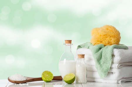 guest room: Spa treatment with lime and salts with towels and sponge Stock Photo