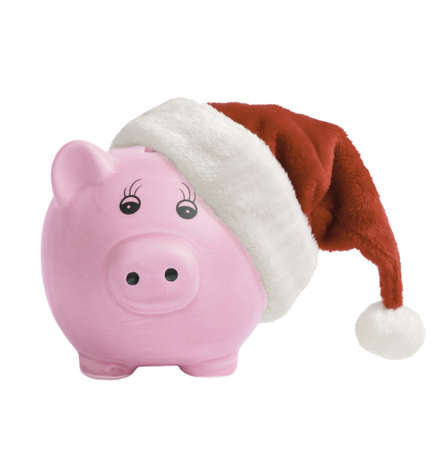 Piggy bank wearing a santa hat - Christmas savings concept photo