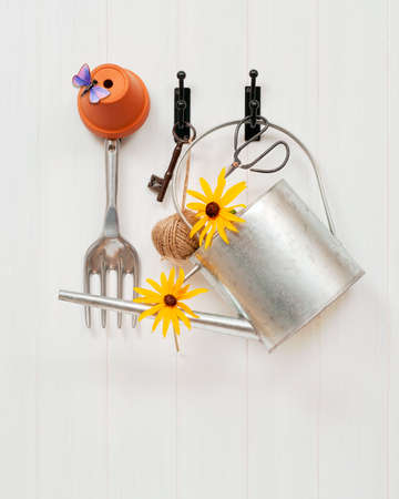 allotment: Gardening tools and shed key hanging on door Stock Photo