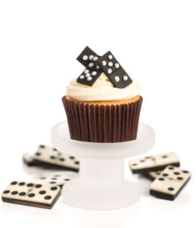 dominoes: Domino cupcake on stand with white background