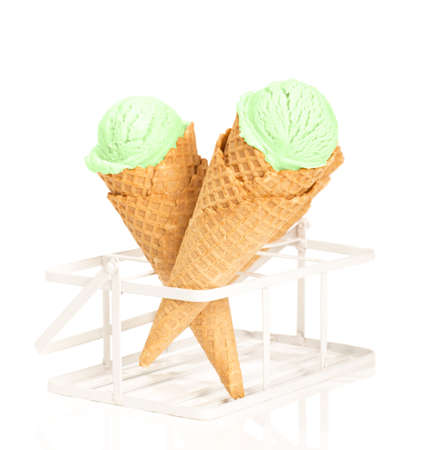 minty: Mint ice creams in waffle cones on white background Stock Photo