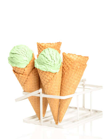 minty: Minty ice creams with waffle cones on a white background Stock Photo