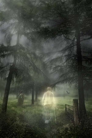 cemeteries: Ghostly figure of an elderly gentleman walking into a woodland graveyard