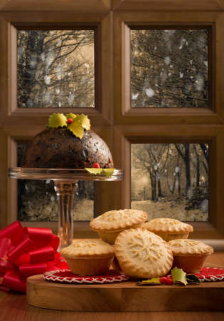 mincing: Christmas mince pies against snowy outdoor scene