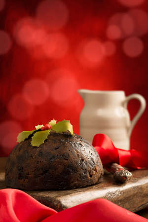 Christmas pudding with red bokeh background photo