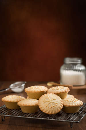 fayre: Baking mince pies for Christmas with festive background Stock Photo
