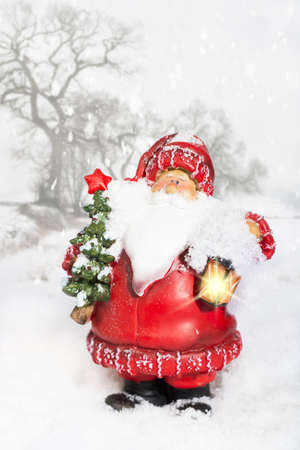 Father Christmas with glowing lantern in snowy winter scene Stock Photo - 16829697