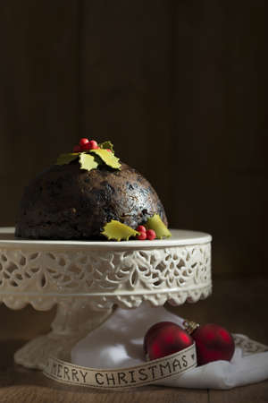 fayre: Christmas pudding on comport with ribbon and baubles