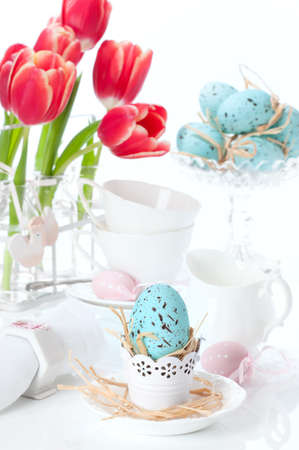 teatime: Pretty blue and pink Easter eggs in teatime setting