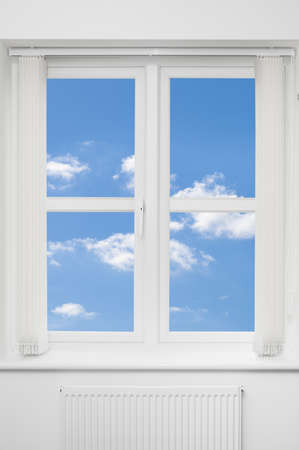 ledge: Beautiful view of blue summer sky through a white window Stock Photo