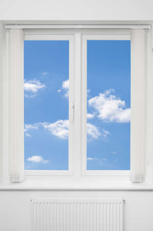 view window: Beautiful view of blue summer sky through a white window Stock Photo