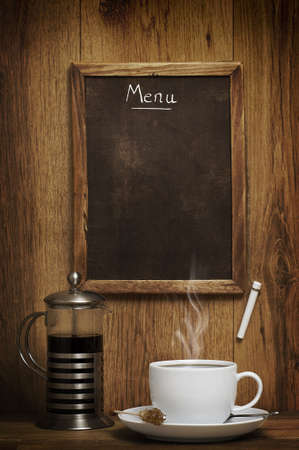 Cup of coffee with menu chalk board photo