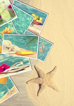 Holiday postcards on sandy wooden decking with starfish photo