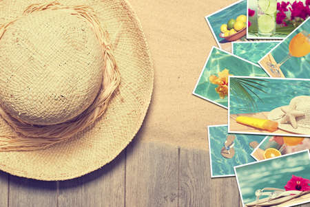 Straw sunhat with postcards of summer vacation photo
