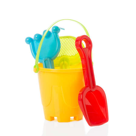 spades: Bucket and spade for the beach on a white background