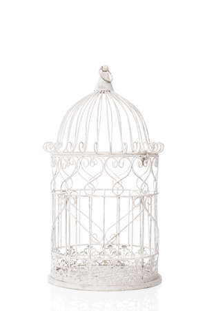 Old antique birdcage on a white background Stock Photo