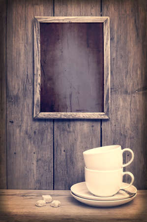 Stack of coffee cups with menu board - rustic setting photo